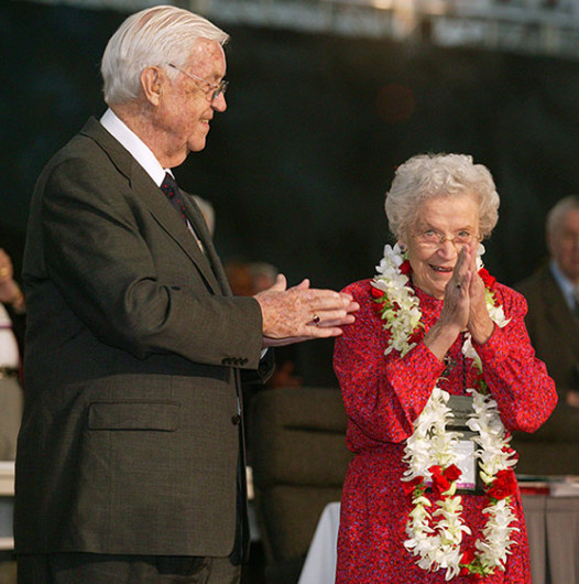 Eunice Mathews acknowledges applause from delegates and guests as the United Methodist Church's 2004 General Conference in Pittsburgh celebrates her lifetime of service to the church. The conference honored Mathews on her 90th birthday. Joining the tribute is her husband, Bishop James K. Mathews. Photo by Mike DuBose.
