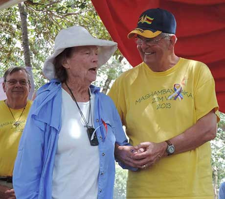 Claire Burrill, 90, and Charlie Moore help celebrate the dedication of new classrooms. Photo by Eveline Chikwanah.