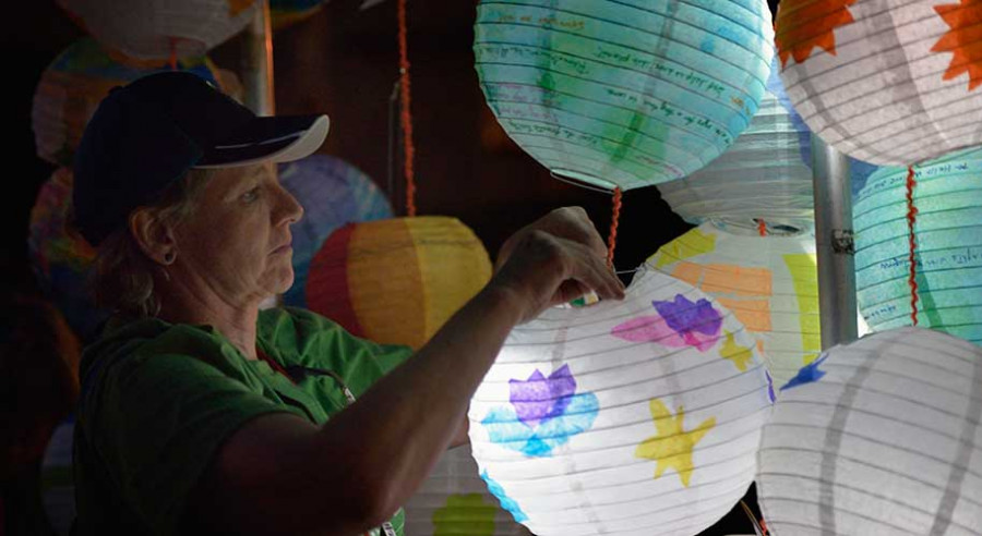 The Rev. Cindy Roberts disassembles lanterns following a May 12 climate vigil outside the 2016 United Methodist General Conference in Portland, Ore. The lanterns were lit with a small solar light that following the vigil were sent to community groups in the Philippines, the Democratic Republic of the Congo, and the United States. Donohew is pastor of Brownsville UMC in the U.S. state of Washington. Photo by Paul Jeffrey, UMNS.