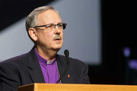 Bishop Bruce R. Ough, president of the United Methodist Council of Bishops, addresses the 2016 United Methodist General Conference May 17 in Portland, Ore., responding to social media posts claiming the church's bishops are calling for a special General Conference in to discuss a possible split. Ough emphasized the bishops remain committed to the unity of the denomination. Photo by Mike DuBose, UMNS.