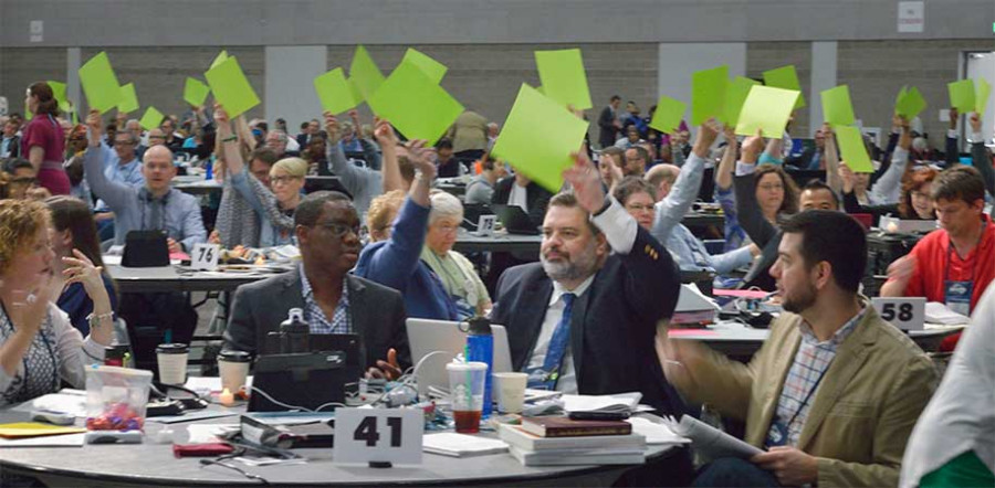 Faced with glitches in the electronic voting system, delegates use colored cards to vote on May 16 at the 2016 United Methodist General Conference in Portland, Ore. Photo by Paul Jeffrey, UMNS.