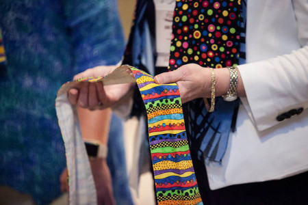 Supporters of full inclusion for LGBTQ clergy wore rainbow-colored stoles throughout Annual Conference. Several gathered in the hotel's main lobby area as a witness to their cause June 3.