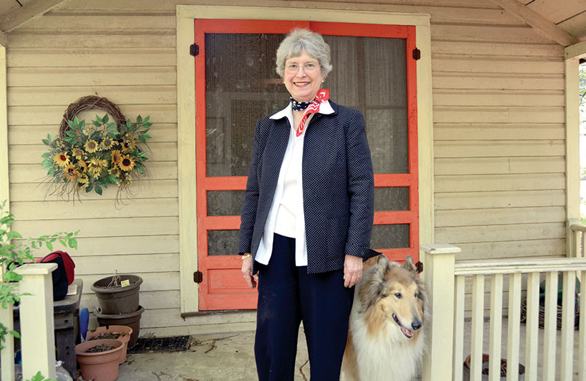 Ann Weller Dahl stands in front of her cottage at Emory Grove, along with a neighbor's collie, Fred. Emory Grove celebrates 150 years in ministry in 2017.