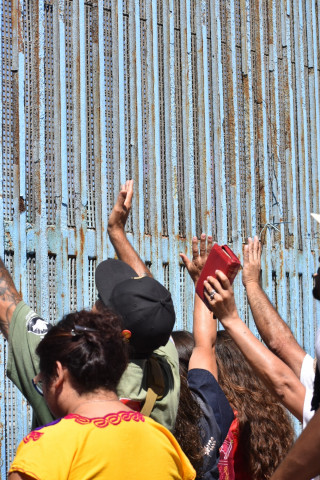 Touching the border wall at friendship park in Tijuana